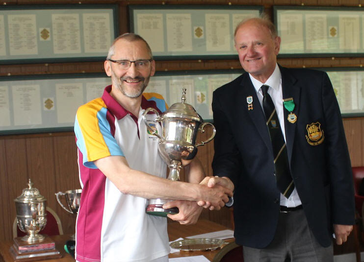 bowler with trophy