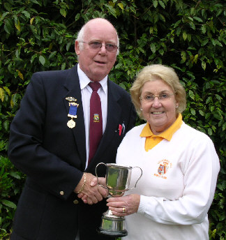 Kath Matthews receives trophy from Captain Rod Payne