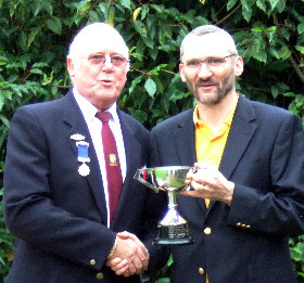 Quentin Smith receives trophy from Captain Rod Payne