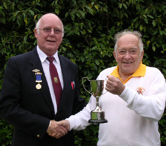George Chambers receives trophy from Captain Rod Payne