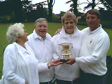 Beryl Borrett presents the trophy to (from left) Derek Taylor, Pauline Scott & Emrys Davies